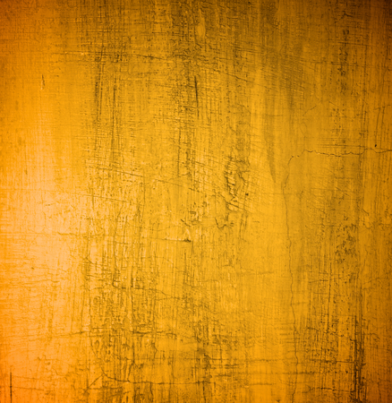 Golden Damaged Obsolete Cement Wall Background closeup Stock Photo