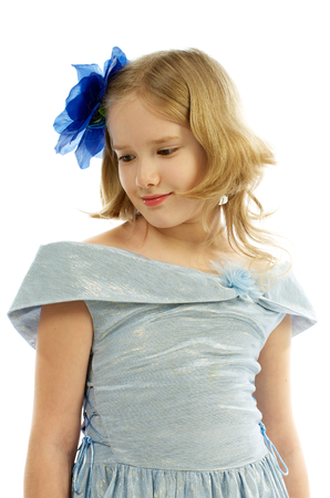 Young Girl in Princess Dress Blue Bow in her Hair isolated on white background photo