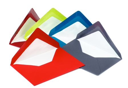 colored paper: Arrangement of Five Colored Paper Envelopes isolated on white background