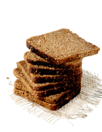 multi grain: Sliced Multi Grain Brown Bread on Sackcloth isolated on white background Stock Photo
