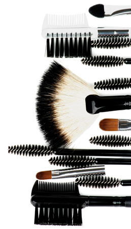 Frame of Various Make-up Brushes and Applicators closeup on white background photo