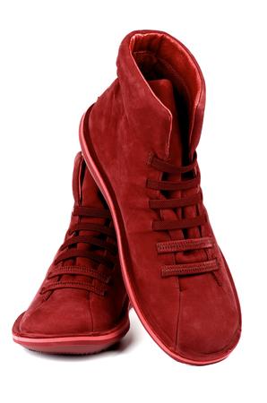 Fashionable Ruby Colored Shammy High Shoes isolated on white background photo