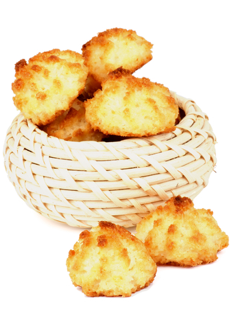 Traditional Homemade Passover Cookies Coconut Macaroons in Wicker Bowl isolated on white background Foto de archivo
