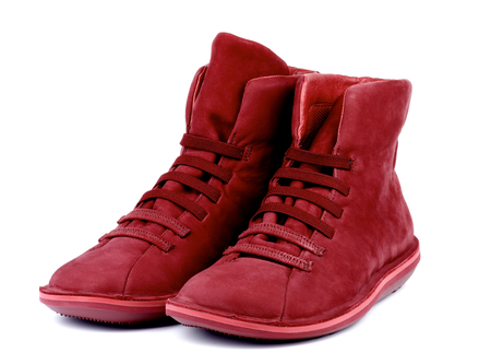 chamois leather: Pair of Fashionable Ruby Colored Shammy High Shoes isolated on white background Stock Photo