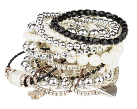 Pile of Various Pearl, Silver and Black Jewelry Gems Bracelets isolated on white background Foto de archivo