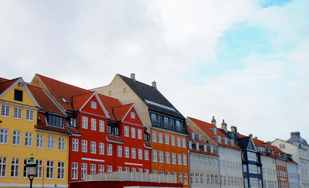 Famous Houses in Nyhavn Copenhagen, Denmark. In Red House in Foreground lived Hans Christian Andersen. photo