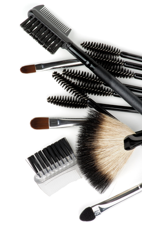 Heap of Various Make-up Brushes and Applicators closeup on white background. Top View photo