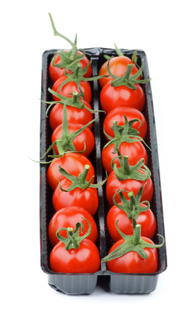 Perfect Ripe Cherry Tomatoes with Stems in Black Plastic Container isolated on white background. Focus on Foreground photo