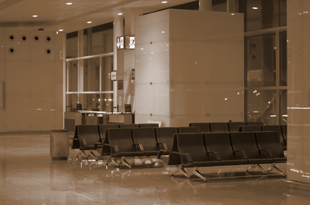 airport lounge: Toned Modern Airport Lounge Zone with Black Chairs. Focus on Foreground