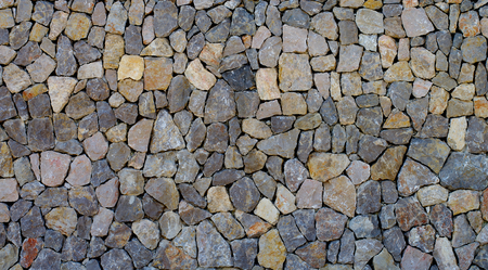 Background of Sharp Grey and Beige Cobblestones closeup Outdoors