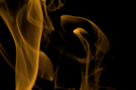 particulates: Abstract Orange Smoke Figures on Black background