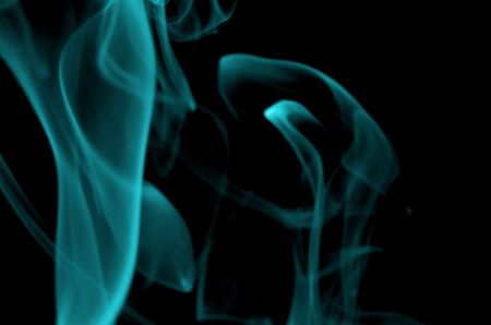 particulates: Abstract Turquoise Smoke Figures on Black background Stock Photo