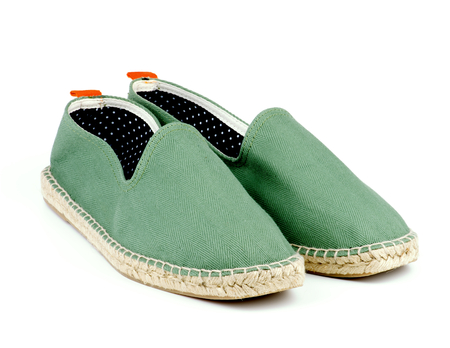 Contemporary Light Green Espadrilles with Polka Dot Lining isolated on White background Foto de archivo