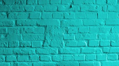 Achtergrond van bakstenen muur geschilderd met mortel Turquoise Color closeup