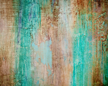Turquoise, Brown and Green Obsolete Cracked Cement Wall Background closeup