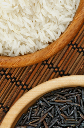 straw mat: Arrangement of White and Brown Rice in Wooden Bowls Cross Section on Straw Mat background