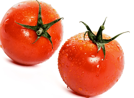 owoców: Two Raw Ripe Tomatoes with Droplets isolated on white background