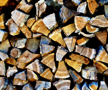 neatly stacked: Stacked Rough Firewood Pinned Segments as Background closeup Outdoors