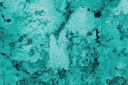 Turquoise Damaged Obsolete Cracked Cement Wall Background closeup Stock Photo