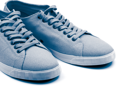 gym shoes: Pair of Grey Gym Shoes isolated on white background. Light Blue Toned