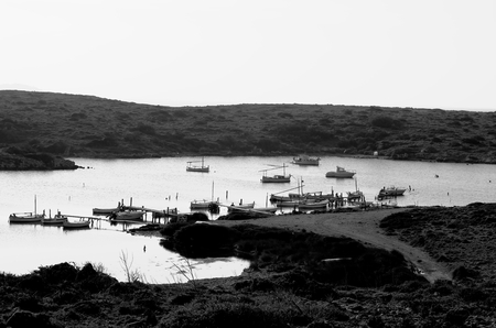 retro styled: Old Small Fishing Bay at South West of Menorca, Balearic Islands. Retro Styled