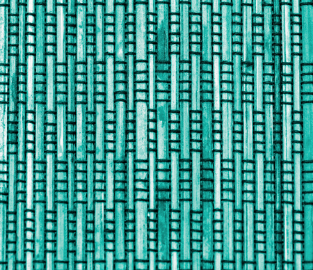 straw mat: Background of Green Bamboo Straw Mat with Black Threads closeup
