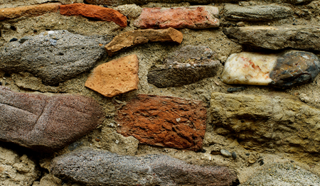 brownstone: Background of Various Big Colored Cracked Stones with Concrete closeup Stock Photo