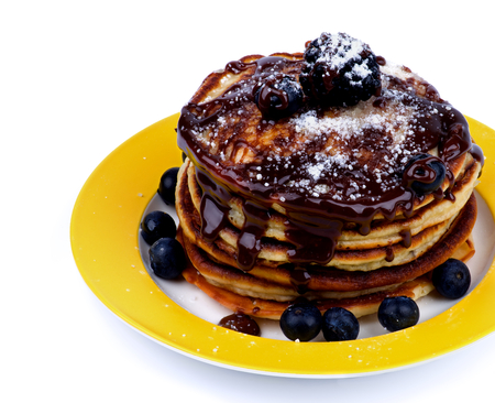 sugar powder: Stack of Delicious Pancakes with Various Forest Berries, Chocolate Glaze and Sugar Powder on Yellow Plate Cross Section on White background