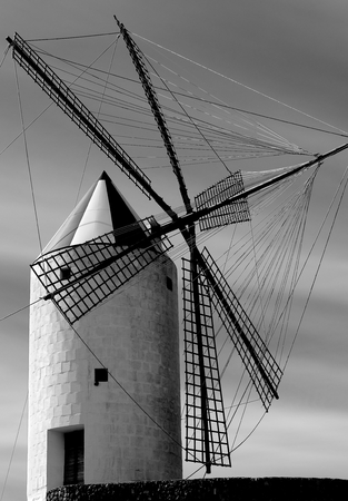 menorca: Beautiful Old Spanish Windmill on Cloudy Sky background in Menorca, Balearic Islands. Black and White Toned