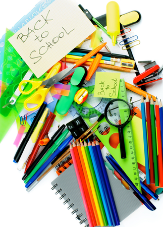 stationery items: Back to School Concept with Various Stationery Items, Paint Brushes, Felt In Pens, Erasers, Note Pads and Lines closeup on white background