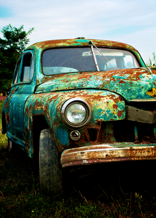 rusty car: Grunge Old Pimped Rusty Car on Blue Sky background Outdoors Stock Photo