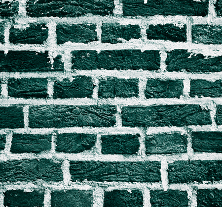 brownstone: Background of Old Turquoise  Brick Wall with Cracked Concrete  closeup Outdoors Stock Photo