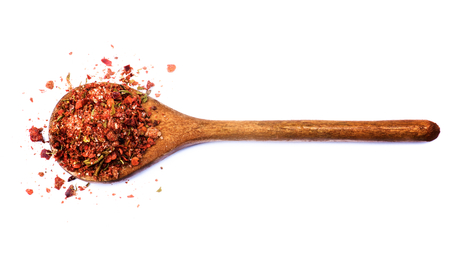 Homemade Dried and Crushed Chili Pepper with Herb and Spices in Wooden Spoon isolated on White background Stock Photo