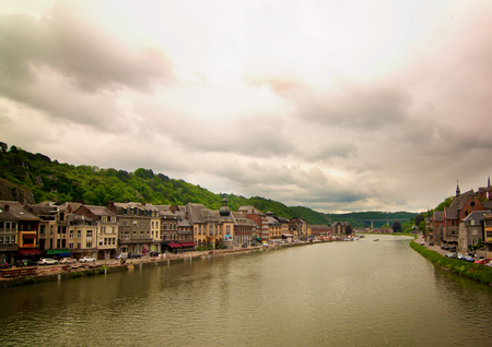 Landscape of Meuse River in Waterfront of Dinant, Belgium in Cloudy Day Outdoors. Retro Styled