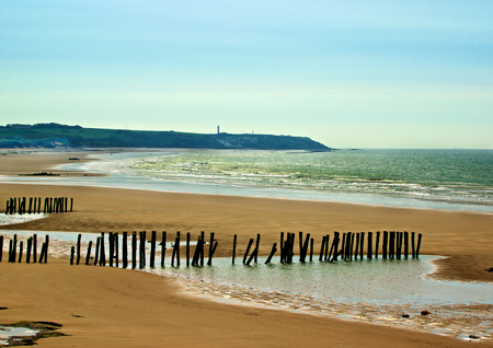 manche: Landscape of French Atlantic Coast with Wooden Breakwaters Outdoors near Sangatte, France