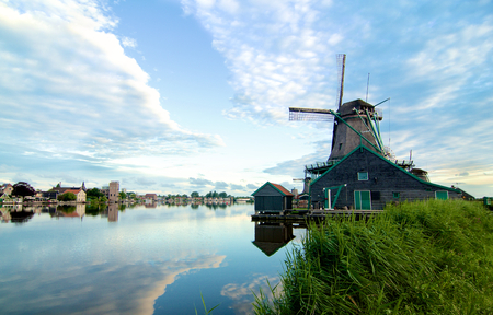 Zaanse Schans Windmill De Kat from River Coast with Reflection of Sky Early Morning Outdoors Editorial