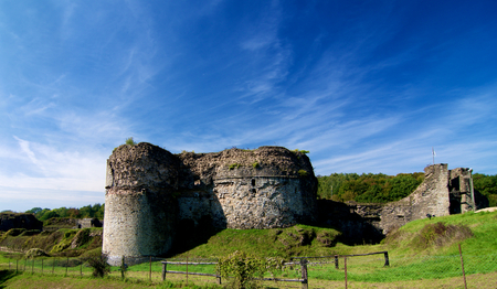 Ruins of Medieval Chateau de Montcornet against Blue Sky in Sunny Day Outdoors. Ardennes, France Stock Photo