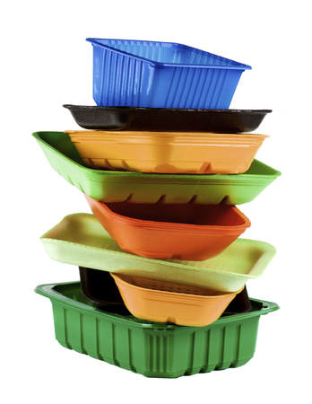 Vertical Stack of Various Colored Empty Recycled Trays isolated on White background