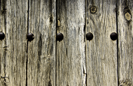 Old Wooden Background with Knotted Cracks and Timber Nail closeup Outdoors Banco de Imagens