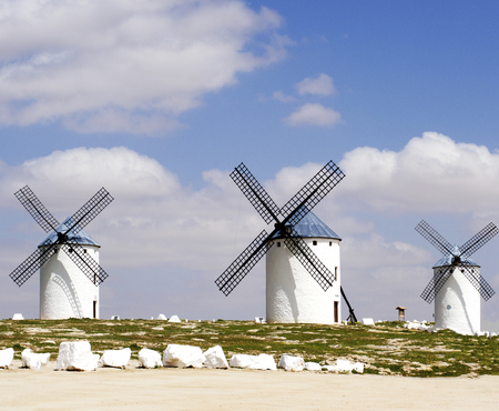 Three Old Spanish Windmills Campo de Criptana against Blue Cloudy Sky Outdoors. Castilla La Mancha, Spain Banco de Imagens