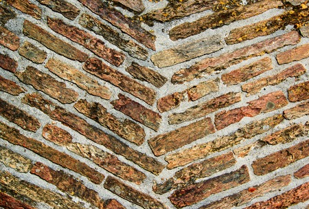 Old Damaged Diagonally Stone Plank Background with Concrete closeup Standard-Bild - 124963169