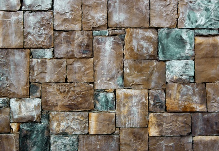 Background of Brown, Sand and Green Cobblestones with Sharp Spears closeup Outdoors Standard-Bild - 124963181
