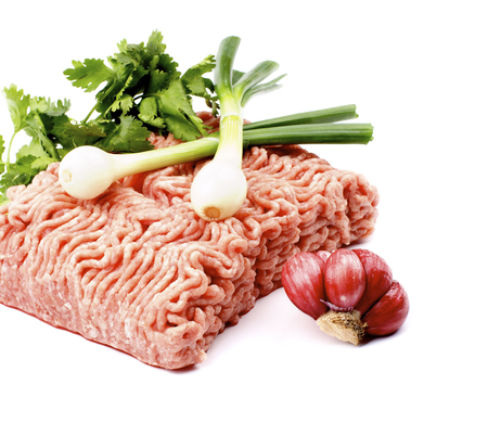 Briquette of Raw Minced Meat with Parsley, Spring Onion and Garlic isolated on White background