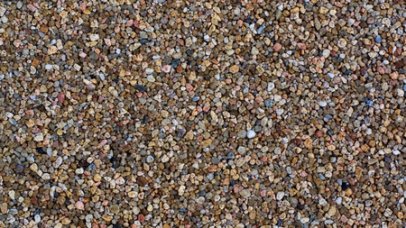 Background of Multi Colored  Small Pebbles closeup Outdoors Standard-Bild - 124963378