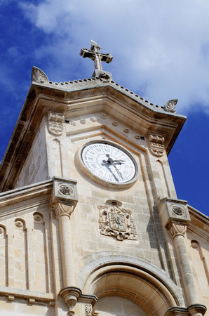 Antique Chapel with Clocks Tower and Seagull on Tip against Blue Cloudy Sky background Outdoors Standard-Bild - 124963384