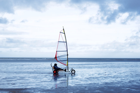 Land Windsurfer on Sea Shore against Cloudy Sky Outdoors. North Sea, Netherlands