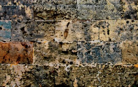 Background of Multi-Colored Wall Stones with Chipped Parts closeup Outdoors Standard-Bild - 124963601