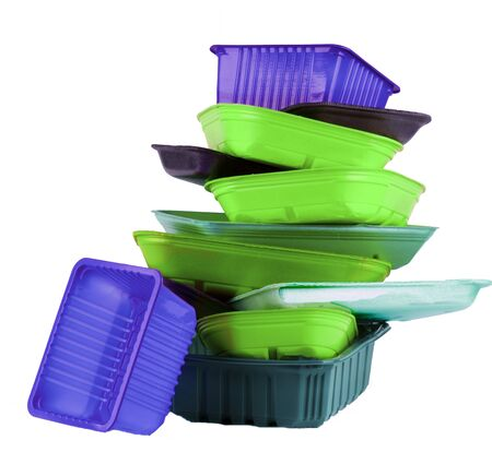 Stack of Various Colorful Fluorescence Empty Recycled Trays isolated on White background