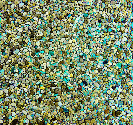 Background of Yellow, Green and Blue Rounded Pebbles closeup