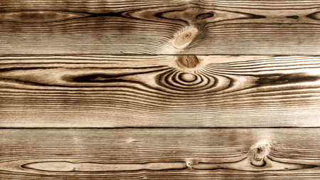 Background of Scorched Wooden Board with Stain Knot closeup Foto de archivo